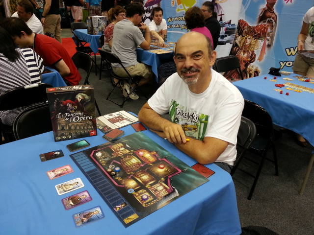 The debonaire Bruno C posing with his newest design at the Asmodee booth
