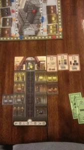 here's a player board. elevator shaft in the middle. three unfilled order cards top right.
