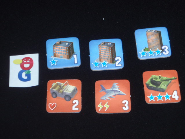 The tokens - blue for buildings, red for military