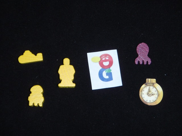 Examples of the bits. Could not resist using the yellow submarine.  The purple piece is an octopod. It is just above a Time Marker