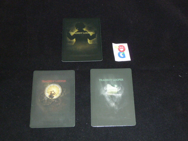 The backs of the three player decks