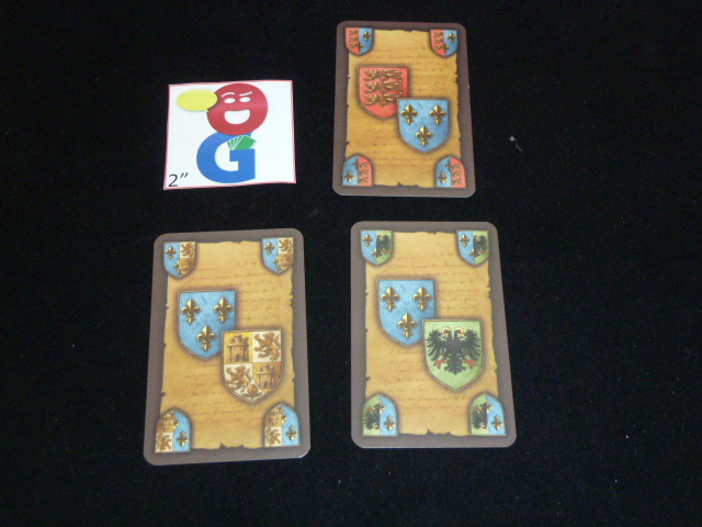 The 3 different varieties of intrigue cards that involve France (the blue country)
