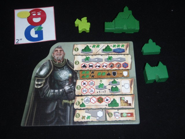 The Green Player Aid and examples of the wooden pieces