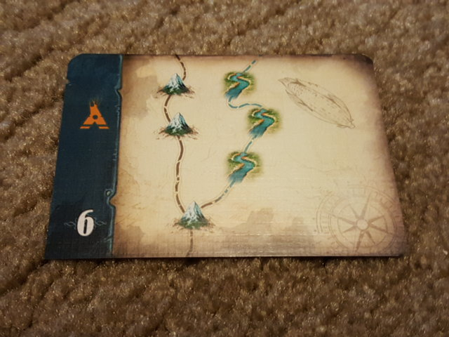 An exploration card. This is either 3 Mountains in a row or 1 mountain and 3 rivers