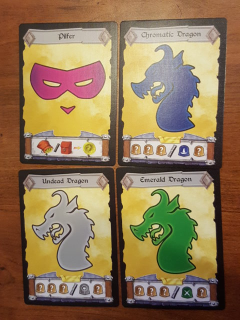 3 Dragon cards and a Pilfer card