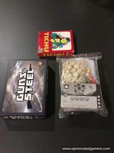 While I don't have confirmation, the entire game fits in the baggie on the right. I'm assuming it'll be in a small box like Guns&Steel seen on the Left. A Tichu box at top for scale.