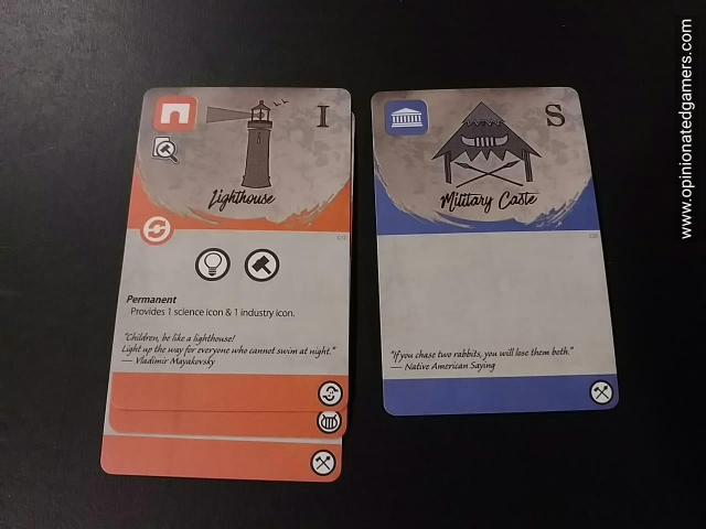 on the left, a stack of Orange cards. As you can see, you can only read one effect - on the top card - but you get all the icons on the bottoms of the cards