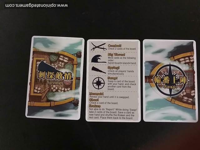 the 2 action cards with the reference card in the center